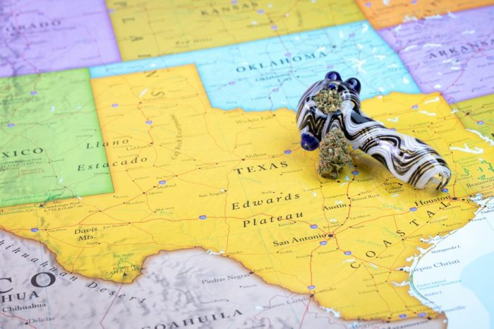 cannabis in texas represented by pipe on map of state