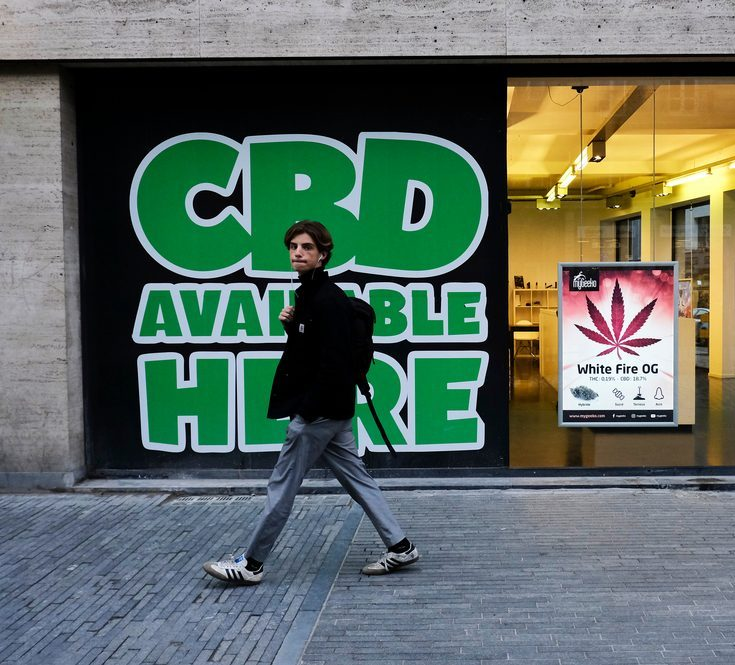 is cbd dangerous might be what this man is thinking as he walks past a cbd sold here sign