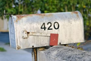 mailing cannabis represented by mailbox 420