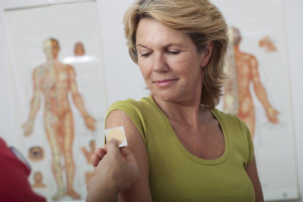 woman receiving thc patch