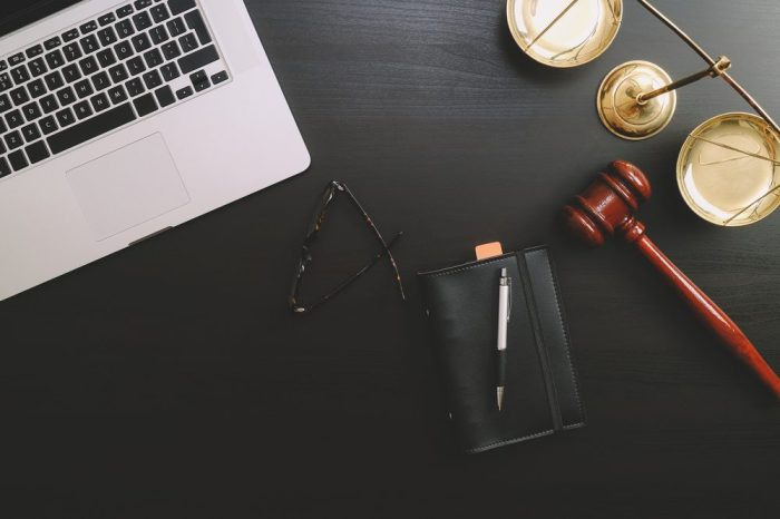 cannabis law reform represented by gavel and laptop on desk