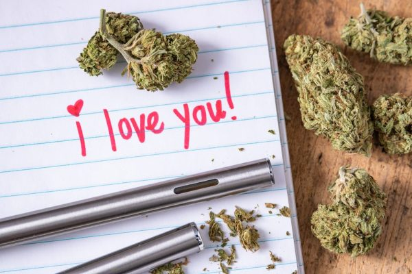 funny valentine represented by I love you written on paper with cannabis buds next to it