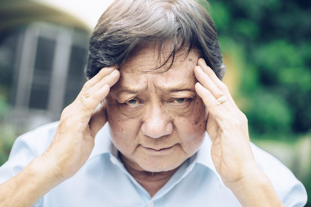 sharp pain in head hurting older man