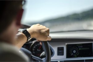 DOES CANNABIS IMPAIR DRIVING might be what this young caucasian man behind the wheel is thinking