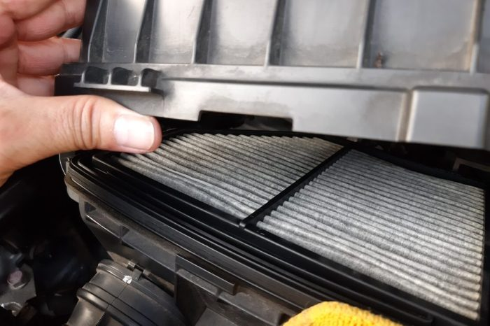 carbon filter being installed by technitian