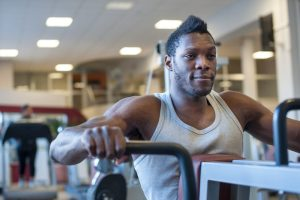 oyung african american man working on muscle development