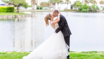Groom leaning back bride for a kiss by the lake - Kingston Plantation Myrtle Beach