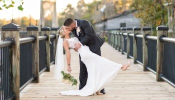 Dip back for a kiss on the boardwalk - Conway River Walk