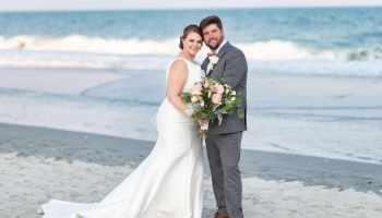 Bride and groom standing by the ocean - Grande Dunes Ocean Club - Myrtle Beach
