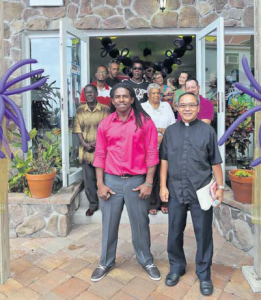 Owner Eric Granger (left), Father Ranulfo Goneda (right) and guests during the opening of Selita Boutique.