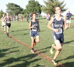 Sophomore Spencer Strahm, right, and freshman Tyrese BIshop finish their race strong on Thursday, September 27, at Horton.