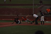 Alejandro Pina is tagged out at home during the Bravos-Brigade contest on Tuesday, July 13.