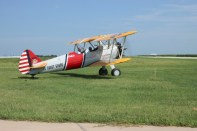 The Dream Flights biplane moves across the grass to the takeoff point on Thursday, August 26.