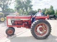 Betty Aue drives a tractor during the Tractor Cruise on Saturday, August 14.