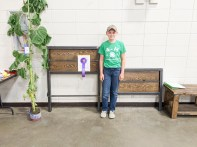 Kenton Farwell earns a Grand Champion ribbon at the Nemaha County Fair for the headboard and footboard he welded.