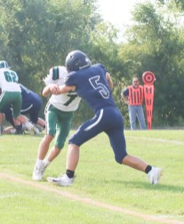 Sophomore Aiden Lang blocks this Chapman player during the junior varsity game on Tuesday, September 7, at Sabetha.