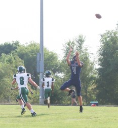 Junior Davis Rokey leaps for the ball during the junior varsity game against Chapman on Tuesday, September 7, at Sabetha.