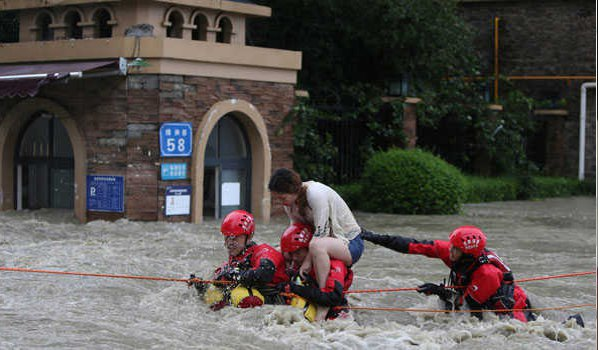 China floods wreak havoc, block roads and railways; more rain due