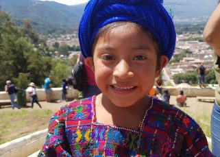 young girl in traditional cloths antigua guatemala