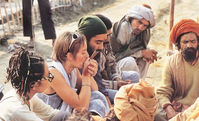 Naga sadhus are talking to the foreigners in the Kumbh fair in Prayagraj