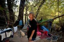 Birdie, shown with her dog Keetcha, was given a notice to vacate her camp along the American River Parkway near Del Paso and Northgate in 2012. A UC Berkeley study being released this week finds that California local governments are increasingly passing and enforcing laws that have the effect of criminalizing homelessness.