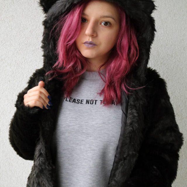 black faux bear fur coat front