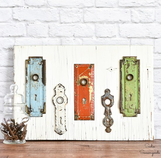 Keyhole covers or vintage hardware on a cupboard door as entryway wall decor