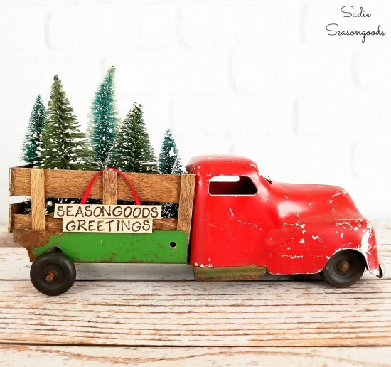 Red truck decor with a red truck with Christmas trees or bottlebrush trees for rustic decor