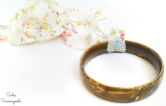 Wrapping the plastic bangles with vintage fabric
