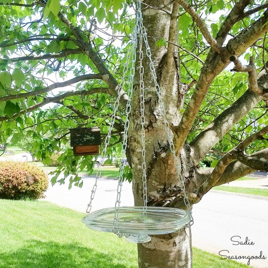 Hanging bird bath by upcycling a glass lid as a bird bath bowl