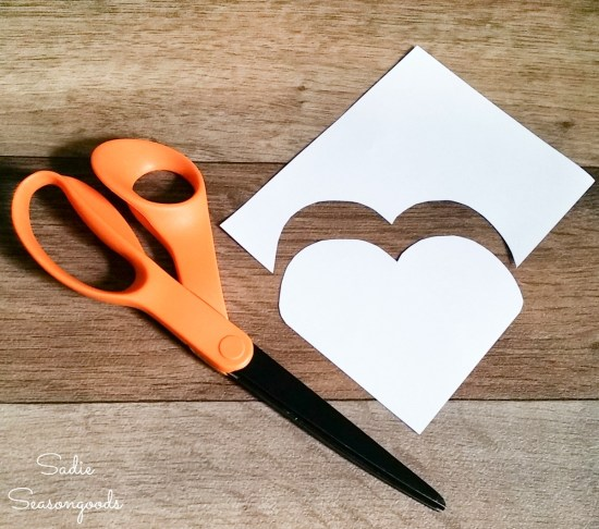 Cutting out a paper template for DIY corner bookmarks