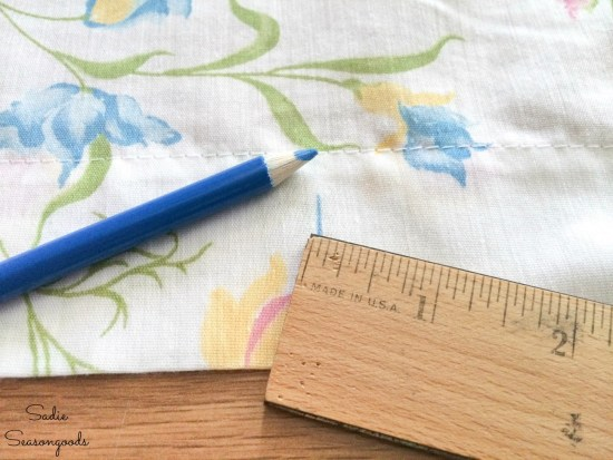 Measuring the placement of buttonholes on a DIY shower curtain