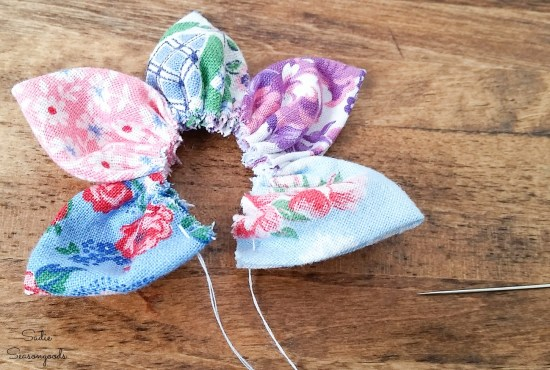 Finishing a lapel flower from grain sack fabric