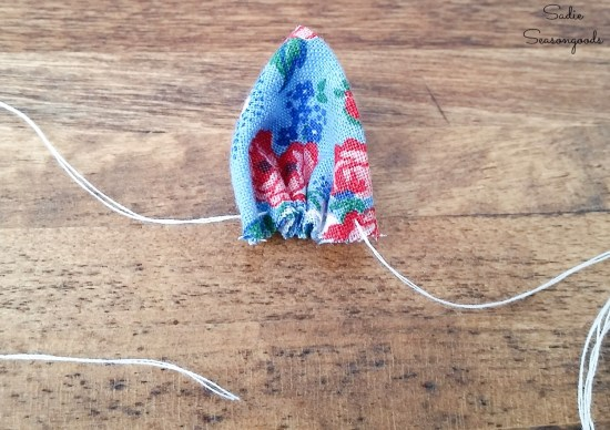 Sewing a floral brooch with vintage fabric