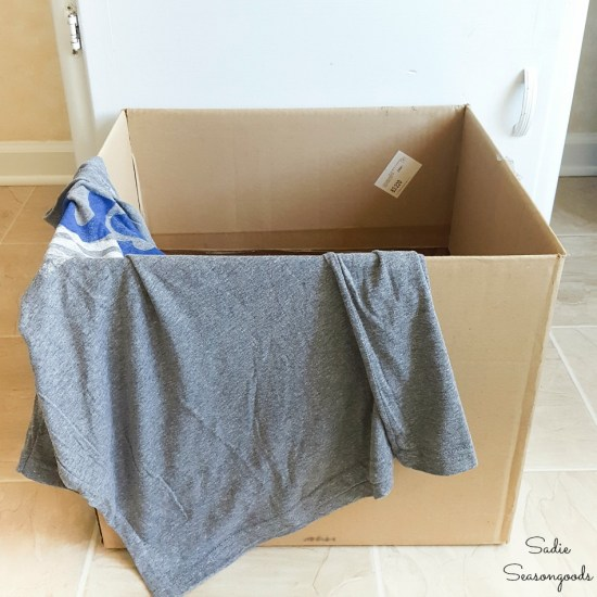 Pet tent with a cardboard box and recycled t shirt