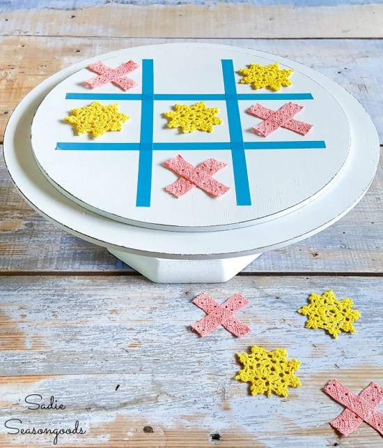 Thrift store makeovers with a wooden cake stand as a tic tac toe board