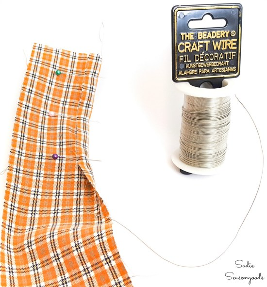Adding wire to plaid ribbon from an upcycled shirt