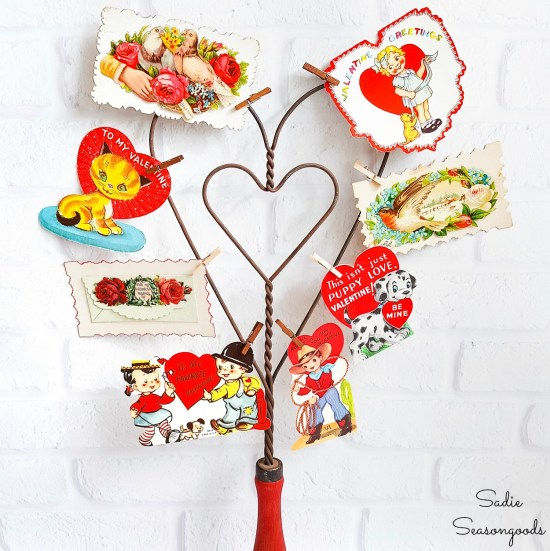 Vintage valentine decorations with a carpet beater for Valentine's Day home decor