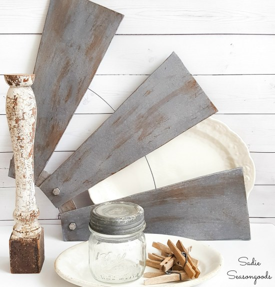 Windmill decor and industrial wall decor with ceiling fan blades that look like a half windmill