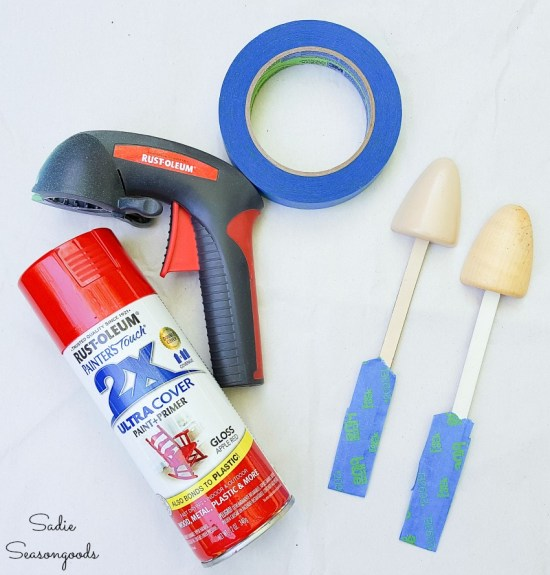 Spray painting a wooden shoe tree for upcycling as mushroom garden decor