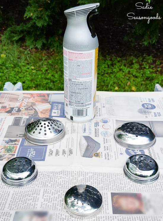 Spray painting a shaker top to be used as a flower frog