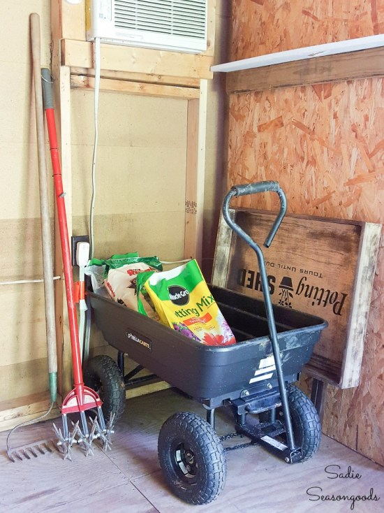 Folding workbench and potting bench in a storage shed