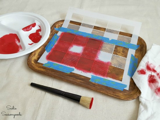 Red craft paint to create Buffalo check decor using a vinyl stencil from Funky Junk Interiors for rustic cabin decor