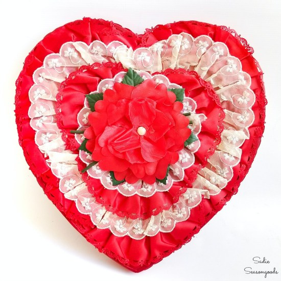 Valentine's Day home decor with a heart shaped chocolate box used as a heart wreath
