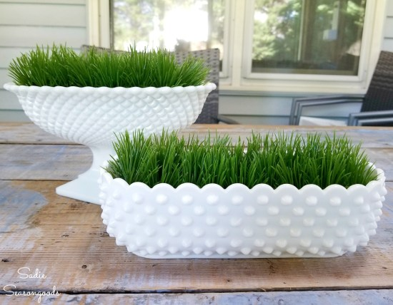 Cutting a plastic grass mat to fit inside the milk glass dishes as Easter decor ideas
