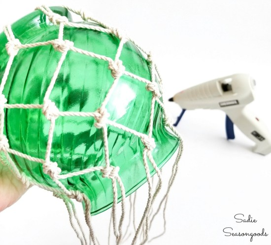 Attaching the netting to the glass fishing floats with hot glue