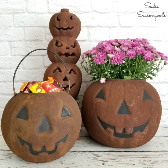 Plastic pumpkins or jack o lantern buckets with a rust patina for primitive Halloween decor