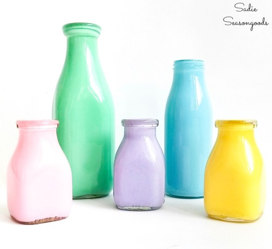 Flower decoration at home with vintage milk bottles as vases with milk caps