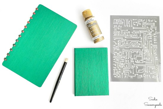 Upcycling a small address book into a password notebook with green metallic paint