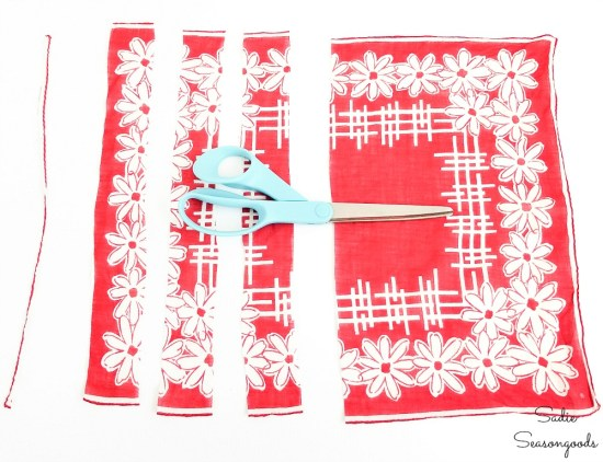 Cutting up a vintage hankie into strips for braiding